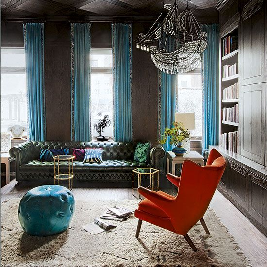 Period properties always have a sense of history attached to them. Use their original features to your advantage and create a dramatic living space. Colour and texture really stands out against the almost-black walls and dark woodwork - golden highlights lift seaweed green and aqua hues, amongst which a striking amber wingback chair makes its presence felt. Just add a ghost-ship-style Halloweeny chandelier, and you're set.