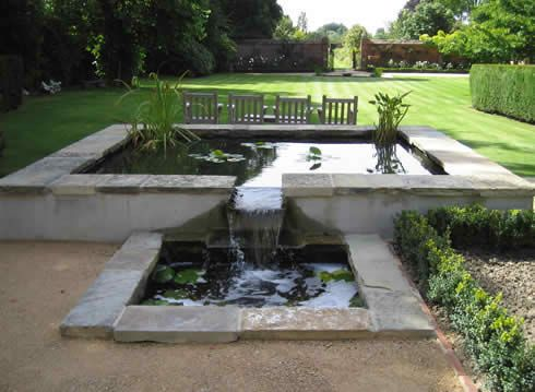 part of a garden design by john brookes nice idea to have a fish pond