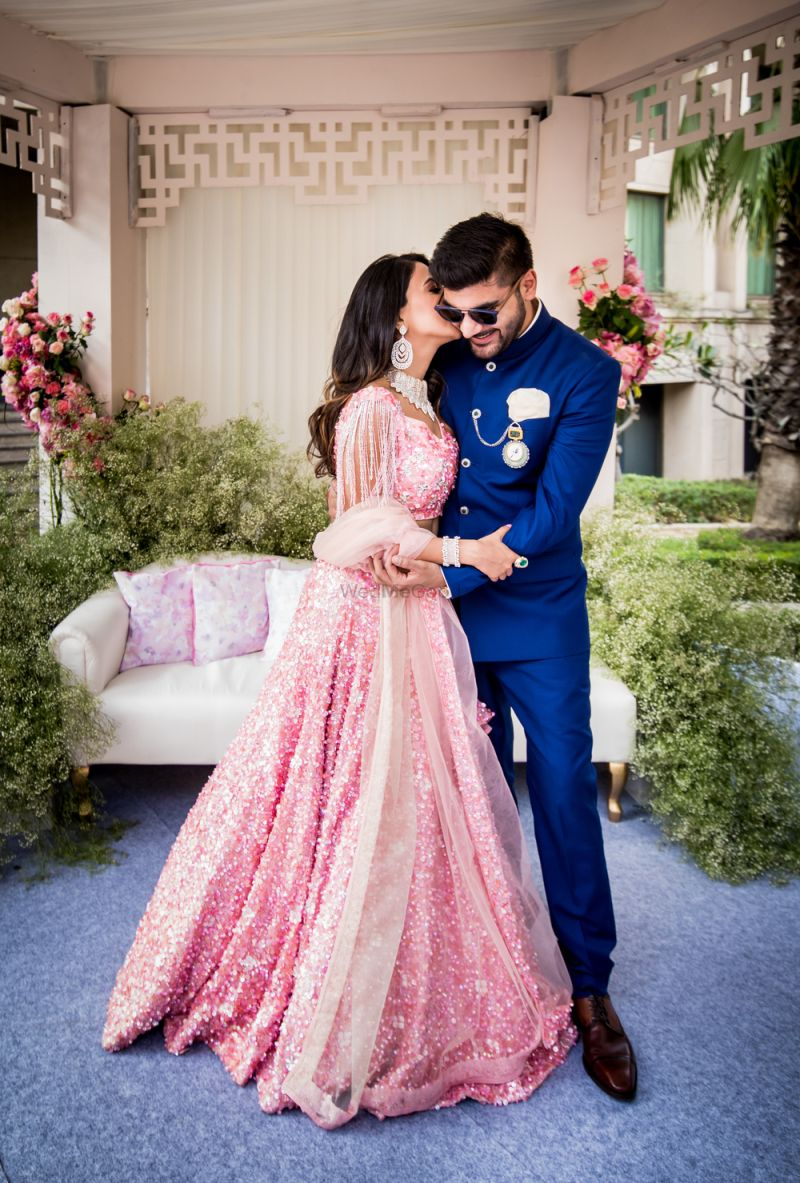 Beautiful couple portrait with pink lehenga WedMeGood