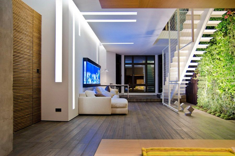 Again, sweet space. Love that fish tank contrasting with the warm wood textures. (Designer Thank Balbek of 2B Group)