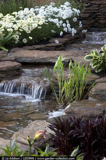 Water fall in a rock garden Diseño de Jardines Pinterest