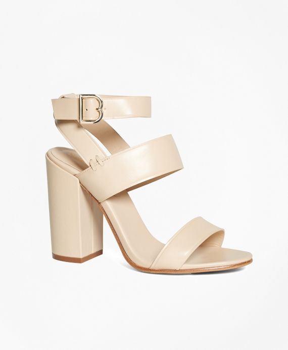 75a83fbc323 These tall stacked sandals are designed with genuine calfskin leather and  feature gold-toned