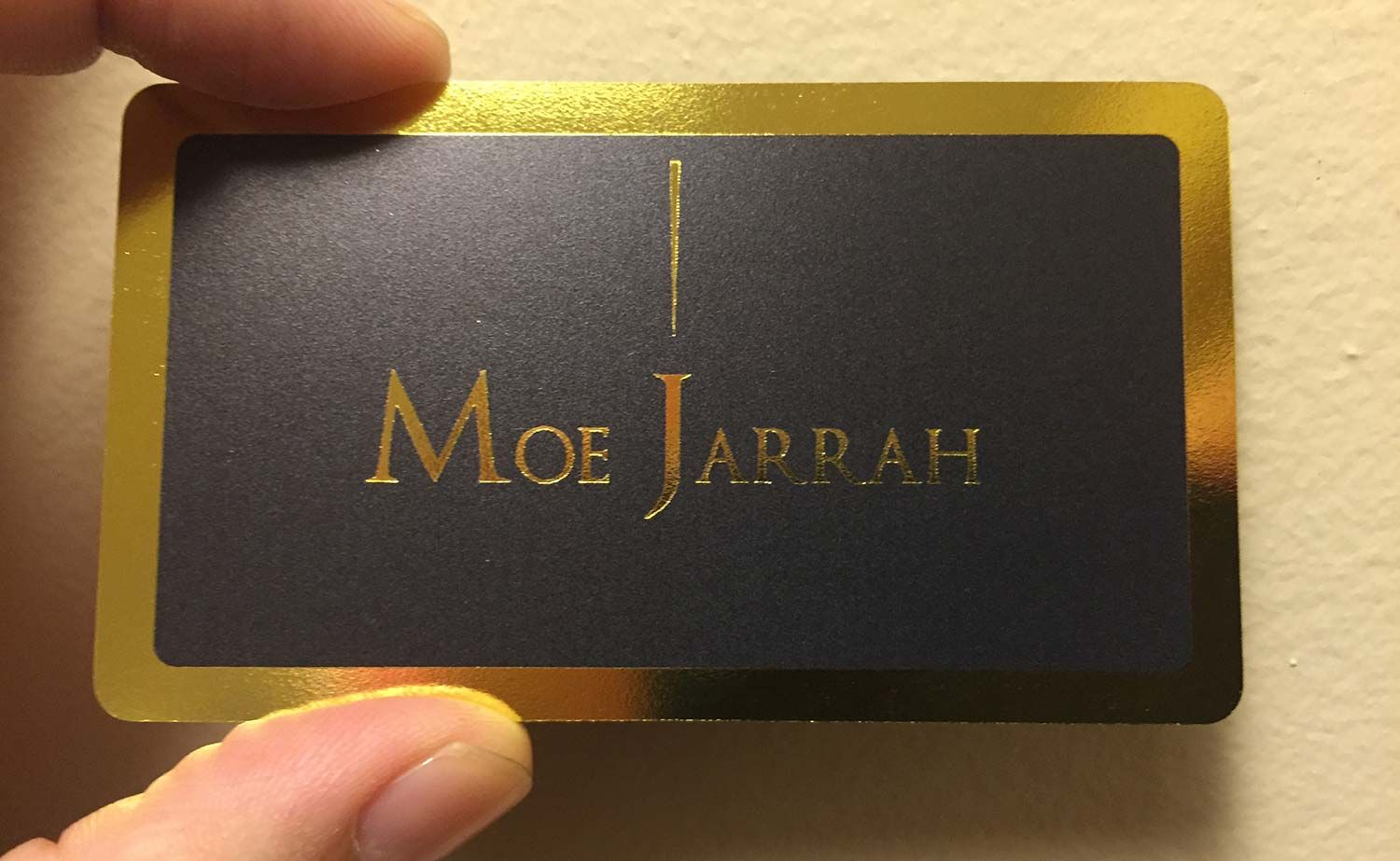 This is an extremely luxurious business card that features a rich ...