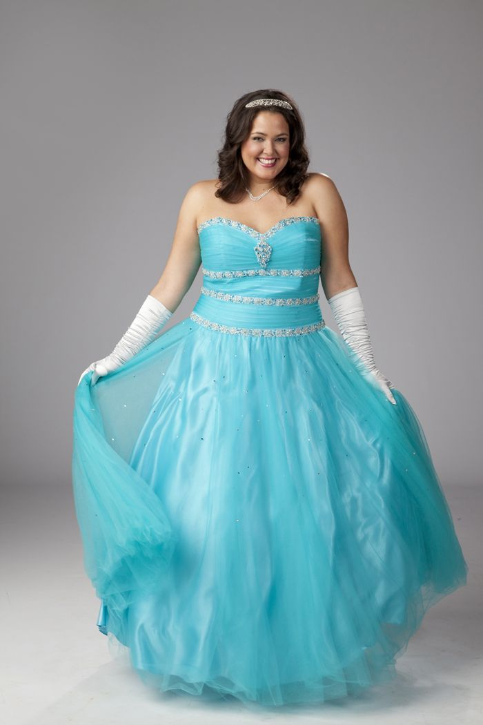 """I absolutely love the look on this model's face!!  She looks partly thrilled to be channeling her inner fairy tale princess; aware that's she """"beyond the age"""" of the normal-aged woman wearing this to prom and feels a little silly; enjoying the thought of wearing this dress to the grocery store or Wal-Mart; and (I hope mostly) happy because she really does look beautiful.  (This link goes to an online store that sells plus-size special-occasion dresses, and they seem to cater to all ages!)"""