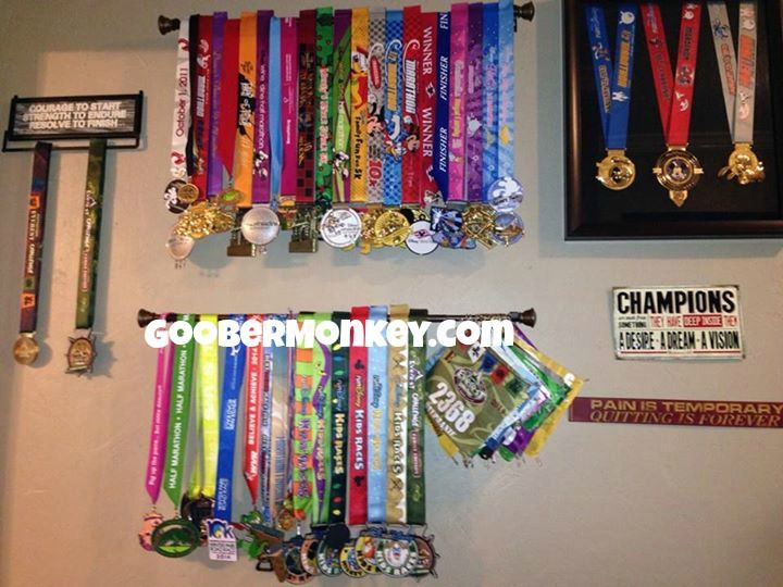 Medal display  Simple curtain rods from Walmart  Much less