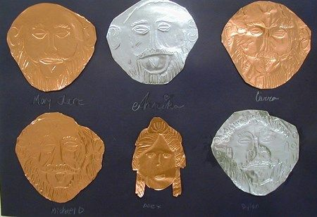 Embossed copper or aluminum mask in the style of King Agamemnon whose mask was pounded gold.