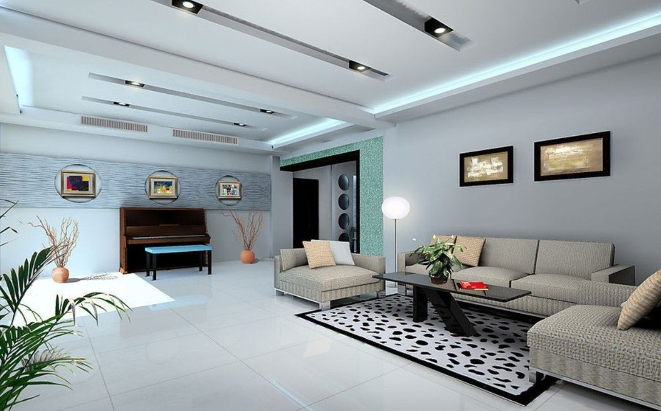 White Color Scheme Large Living Room Ideas With Modern Gray Fabric Sofa Furniture On The White Large Living Room Design Living Room Decor Tips Big Living Rooms