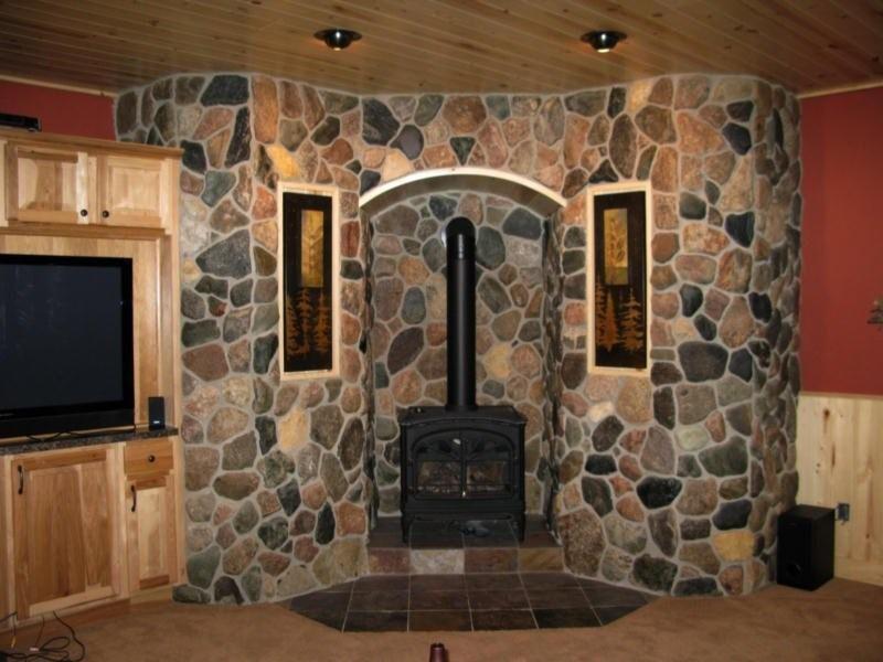 realstone cobble surrounding a basement woodstove cool fireplaces rh pinterest co uk wood stove in basement venting wood stove in basement of camp