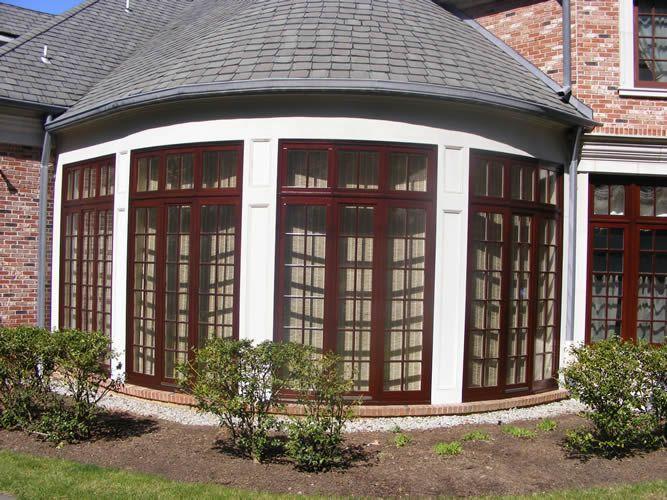 Exterior window treatments -- wooden stain, white trim Window