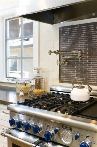 thermador range with blue knobs, dark gray subway tile backsplash ...