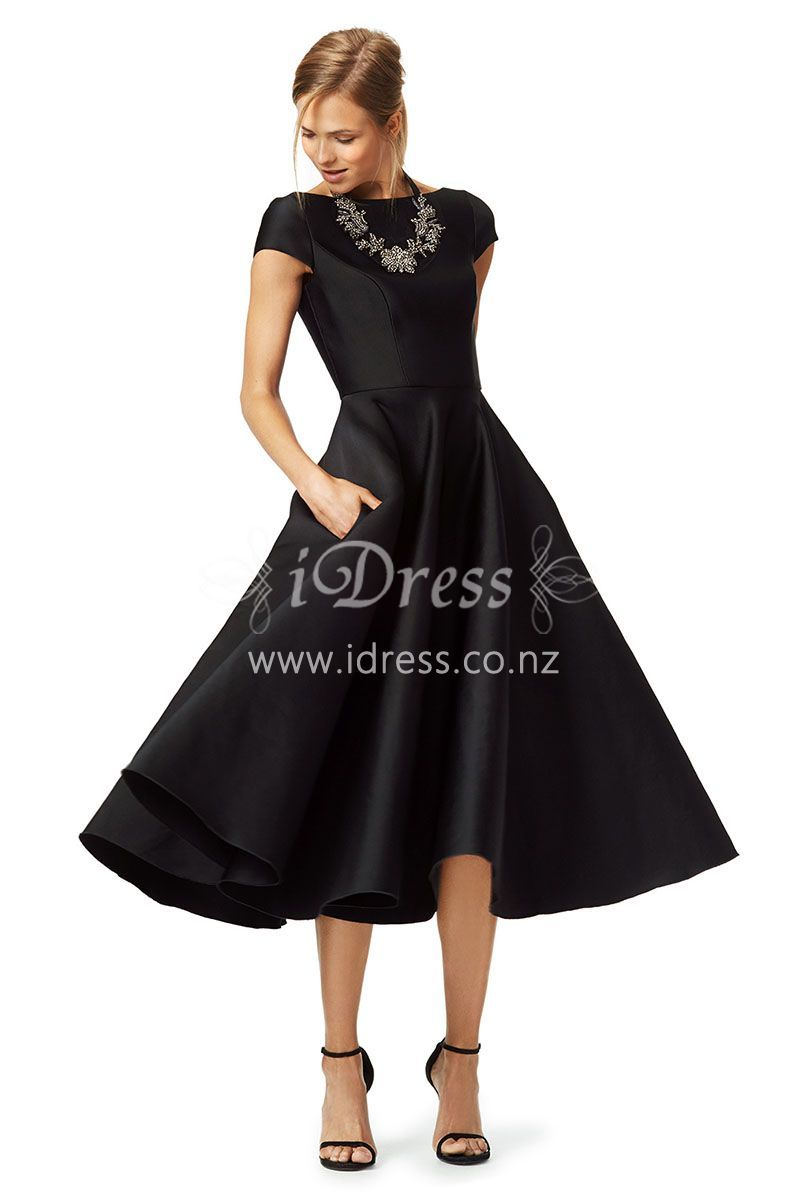 This black satin tea length cocktail dress finishing off mysterious feel and modest look. Cap sleeve jewel neckline bodice, draped textured A-line skirt, V back, zip closure.