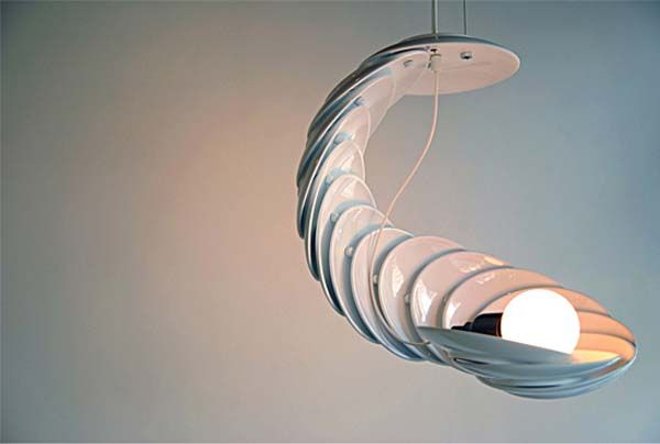 Plates hung in a graceful arch.   Light design ideas from Jung Hwa-Jin 2