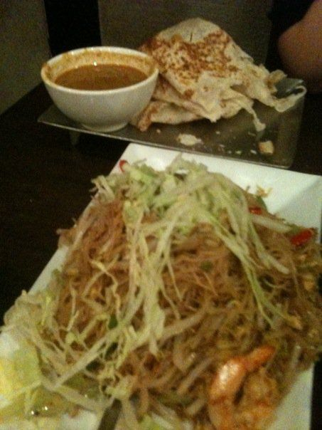 Penang again!     Singapore Noodles and Roti Canai(Indian Pancake) with curry chicken potato dipping sauce.  the best....