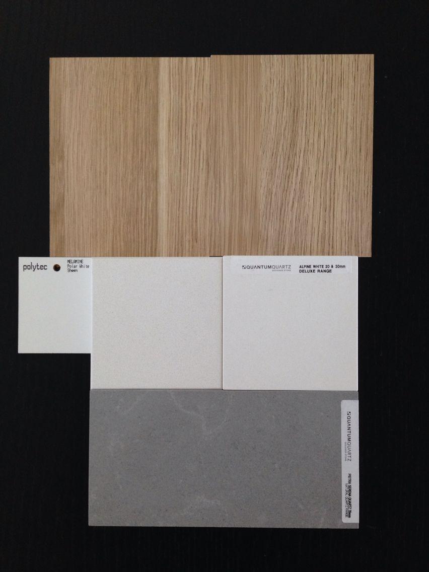 Kitchen colour scheme concrete island bench clean white cabinetry