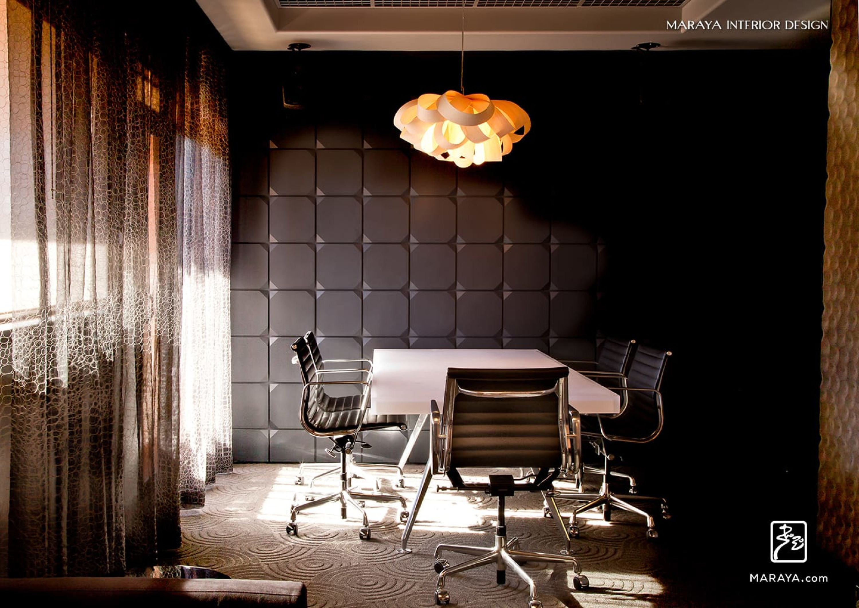 Black Relief Wall In Modern Office With Sheers And Bent Wood Chandelier.  Translucent Table.