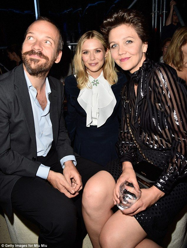 Trio: Maggie hung out with her dapper husband Peter Sarsgaard and Elizabeth Olsen inside...
