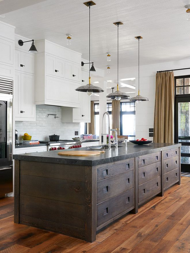 This kitchen is really interesting...from the unique island, to the pendants to the ceiling fixtures (a vintage change up from recessed lighting)