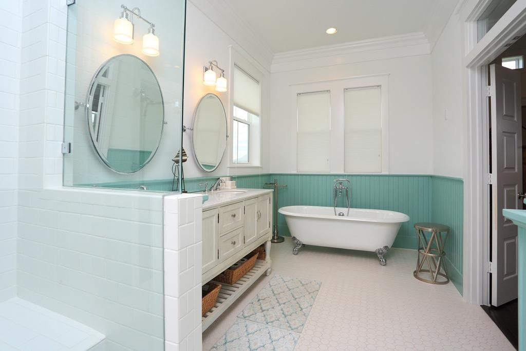 Aqua painted beadboard and the clawfoot tub are fantastic in the vintage inspired beach cottage bathroom