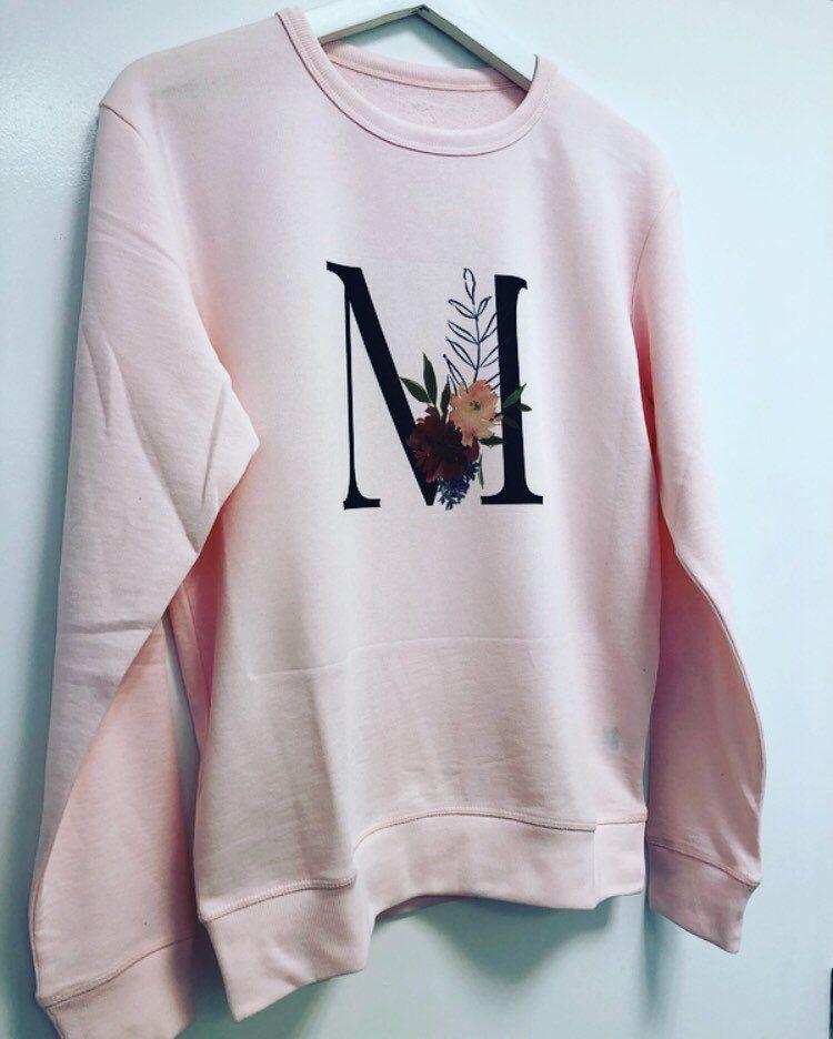30fb45e27 Women s light pink initial jumper with floral alphabet