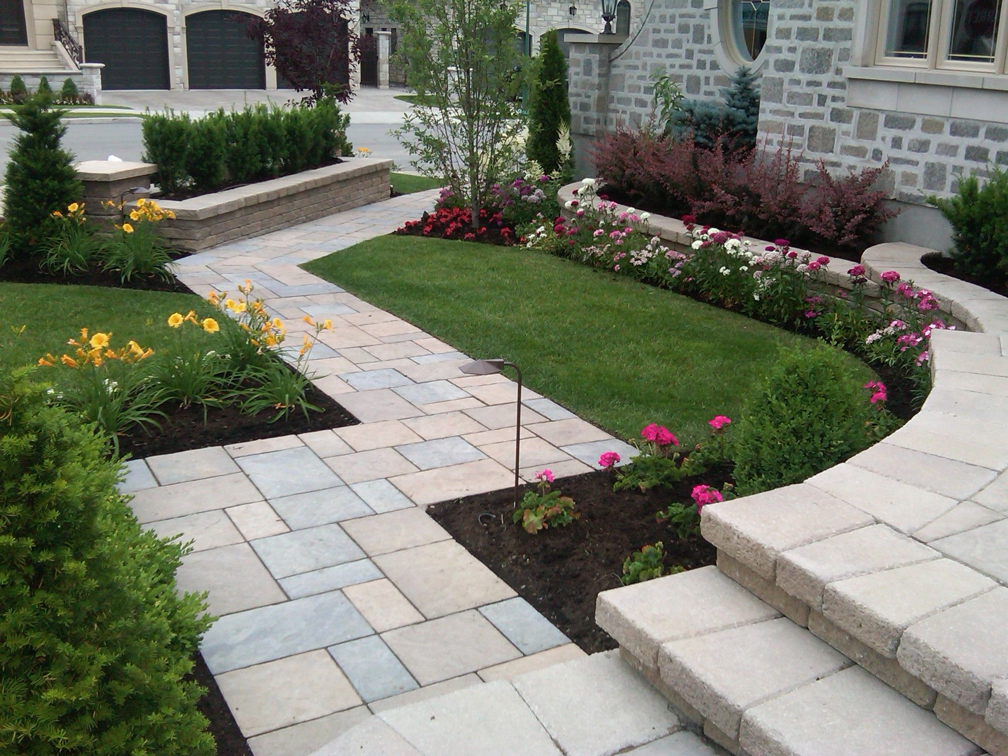 A path with Techo Bloc paver Blu a natural look