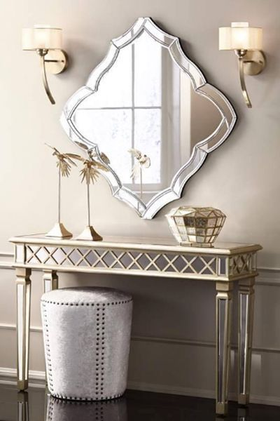 Acentúa. Combina un espejo plateado como este con muebles dorados ...