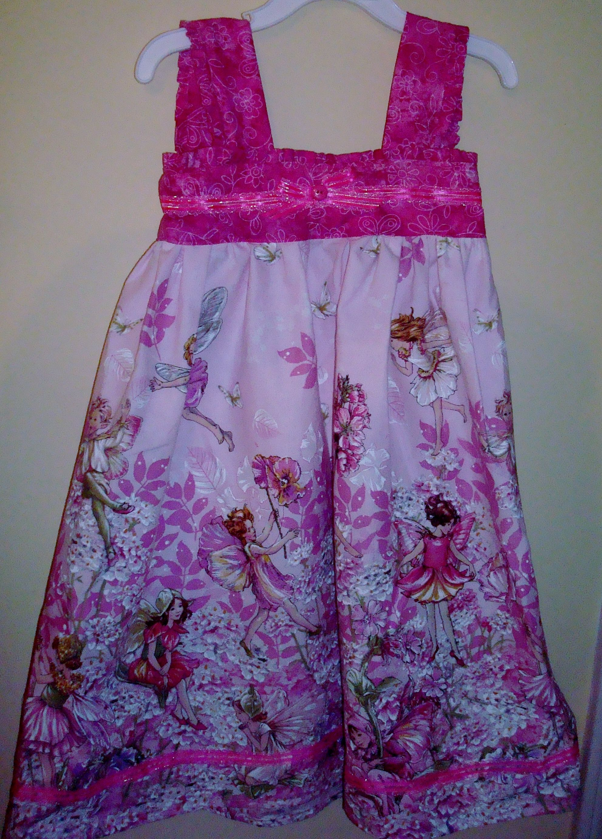 Fairy sundress with ruffled sleeves and chest band - bow off center at my daughter's request :)
