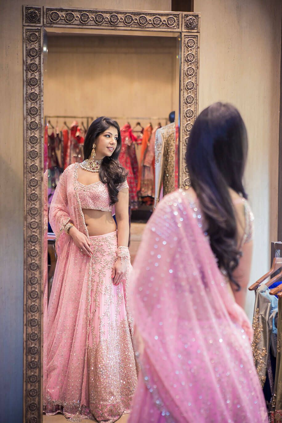 Akriti\'s chic makeover in a baby pink Manish Malhotra lehenga at ...