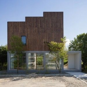 IHRMK's house with a staggered profile  looks out over a landscape of paddy fields