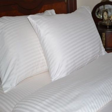"""Details you've been dreaming about and comfort you can count on. The sateen weave of the Cavalli Collection 400 thread count sheets produces a quality feel and soft dreamy drape. You'll be enveloped in the luxury of these 100% Egyptian cotton Striped sheets night after night. What a way to start and end each day! - 100% Egyptian Cotton striped fabric - Lustrous Sateen Finish - Fully elasticized fitted sheet fits mattress up to 18"""" deep - Sheet sets include a flat sheet, fitted sheet and two…"""