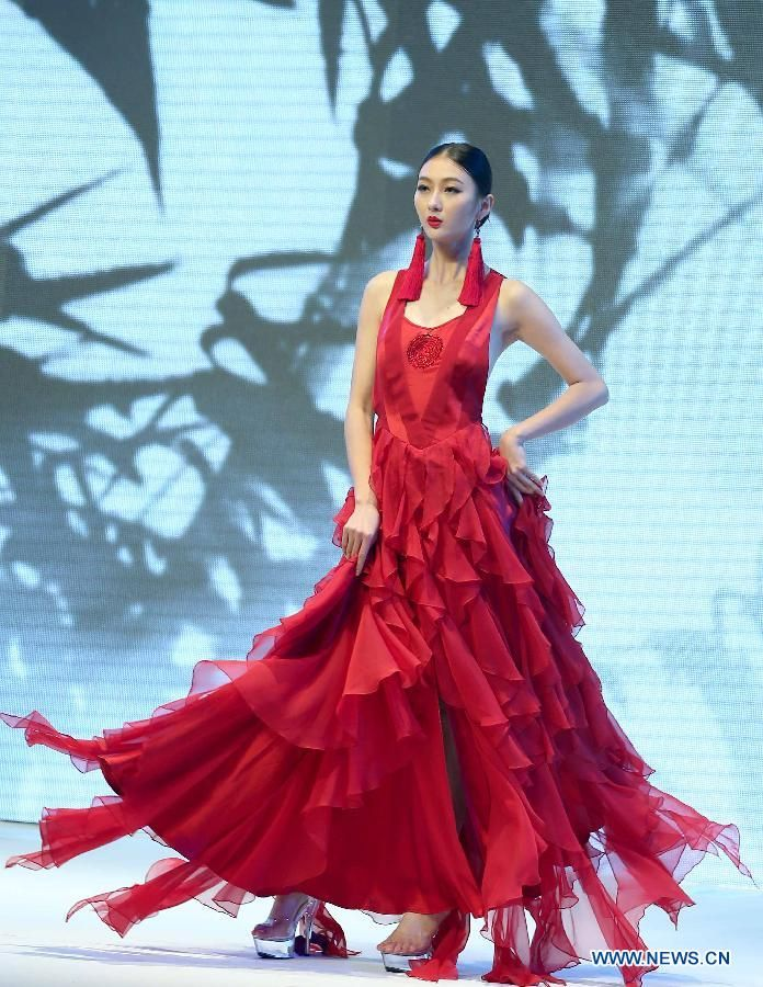 Chinese fashion designer Deng Zhaoping on the opening ceremony of 2013 Guangdong Fashion Week