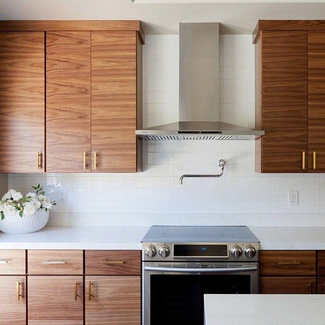 Stunning Walnut Kitchen Cabinets White Counter White Backsplash