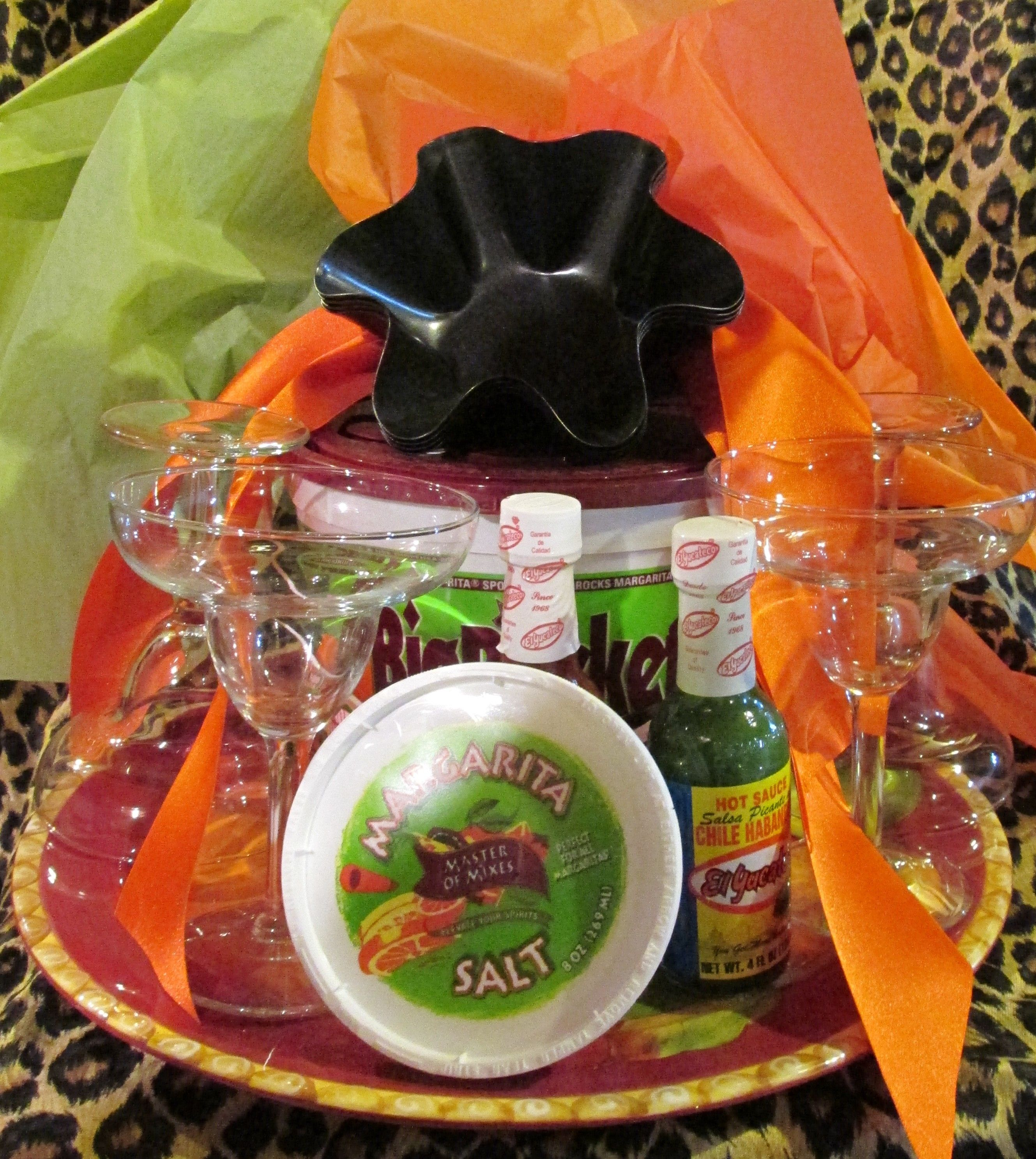 One of our Ole' gifting baskets.  It includes tortilla baking pans, margarita glasses, margarita mixer, hot and mild sauce, and margarita salt  all in a beautiful Spain-inspired  ceramic bowl!  $50 at www.kikiskache.com