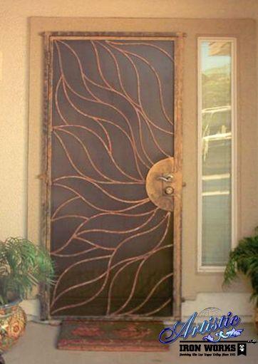 Custom sun wrought iron security door by artistic iron for Door hardware las vegas