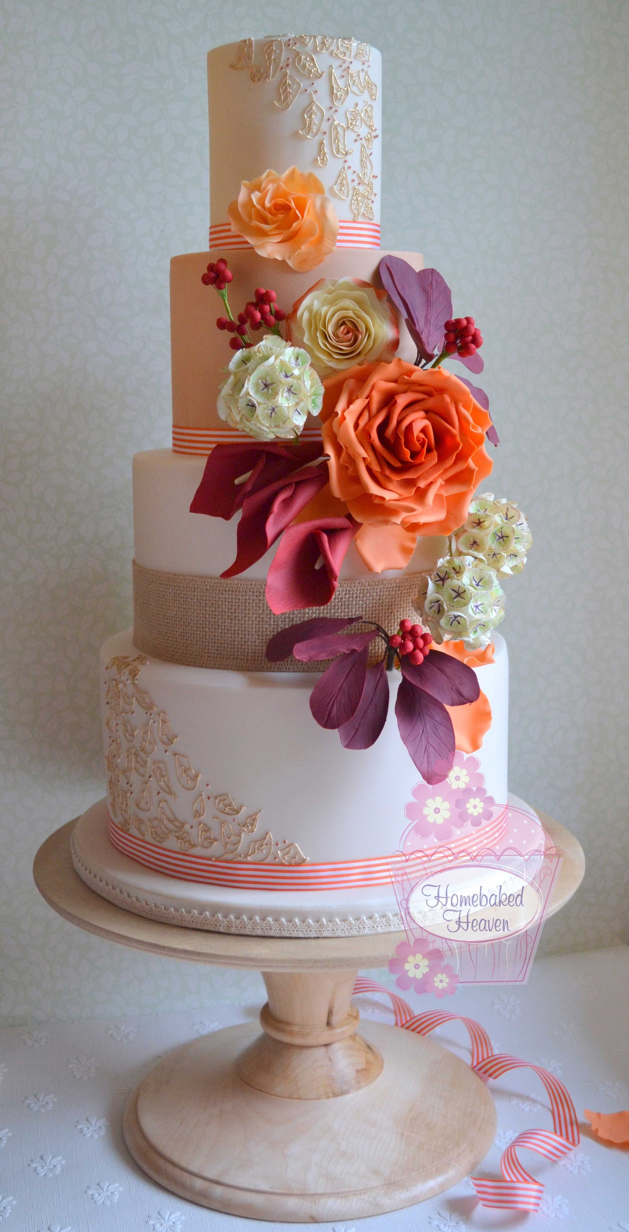 Wedding cake decorated with oversized rose in burnt or