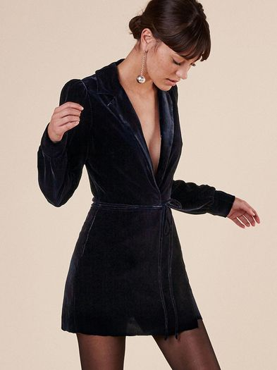 This is part of the Ref x Haim collection. Tights were invented for a reason. This is a mini length, wrap dress with a low v neckline and puff shoulder sleeves. https://www.thereformation.com/products/lindley-dress-navy?utm_source=pinterest&utm_medium=organic&utm_campaign=PinterestOwnedPins
