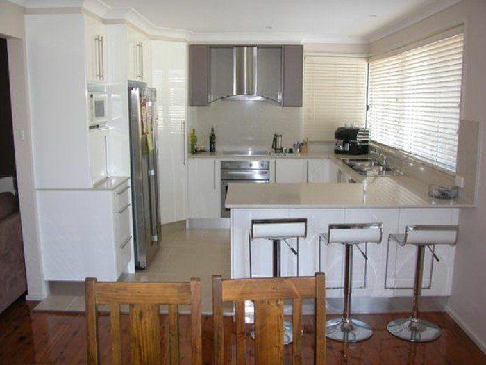 la cuisine en u avec bar voyez les derni res tendances hauts blancs couleur taupe et. Black Bedroom Furniture Sets. Home Design Ideas