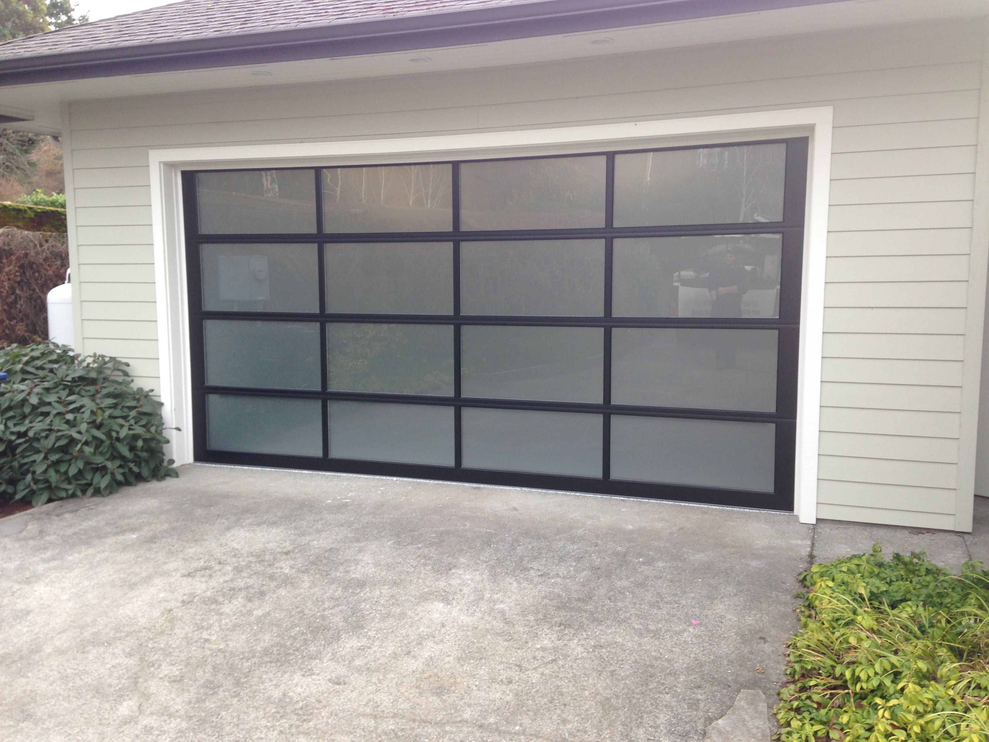 Beautiful avante doors with frosted glass installed by for Beautiful garage doors