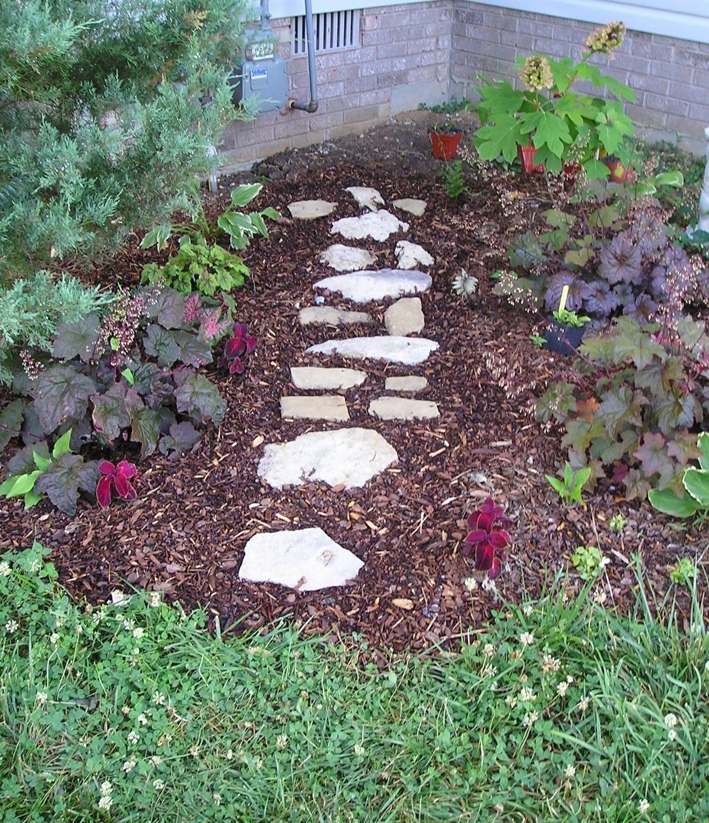 Inexpensive walkway lawn and garden pinterest deck for Rock stepping stones landscaping