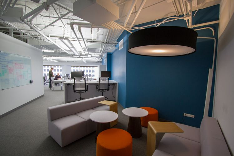 Ewparchitects commercial interior design for siteworks lofted office workplace bold colors eclectic seating