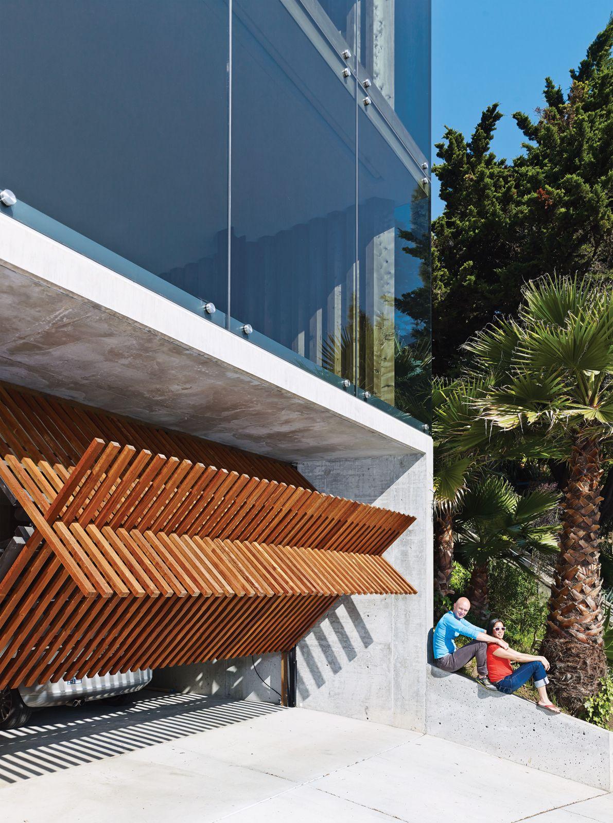Cool residential garage doors - Garage Door Pivots Planks In Two Directions Peter S House Craig Steely