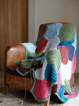 This colourful, patchwork throw is made up of patches of bobble, rib, cable and moss stitch and has been designed by Erika Knight using Amy Butler's Sweet Harmony.
