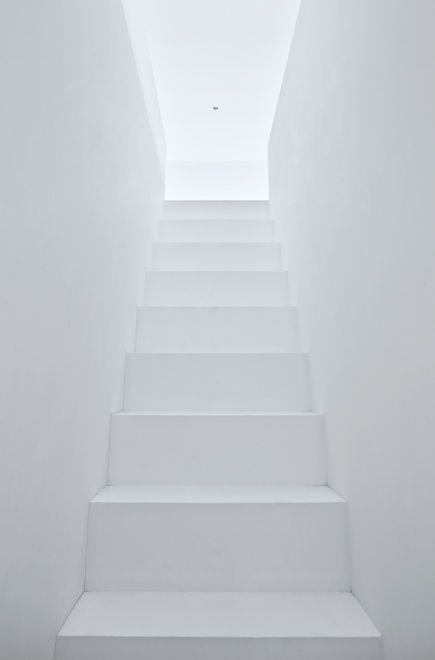 All-white staircase inside the Warehouse by Shinichi Ogawa. Photo by Jonathan Savoie Architecture.