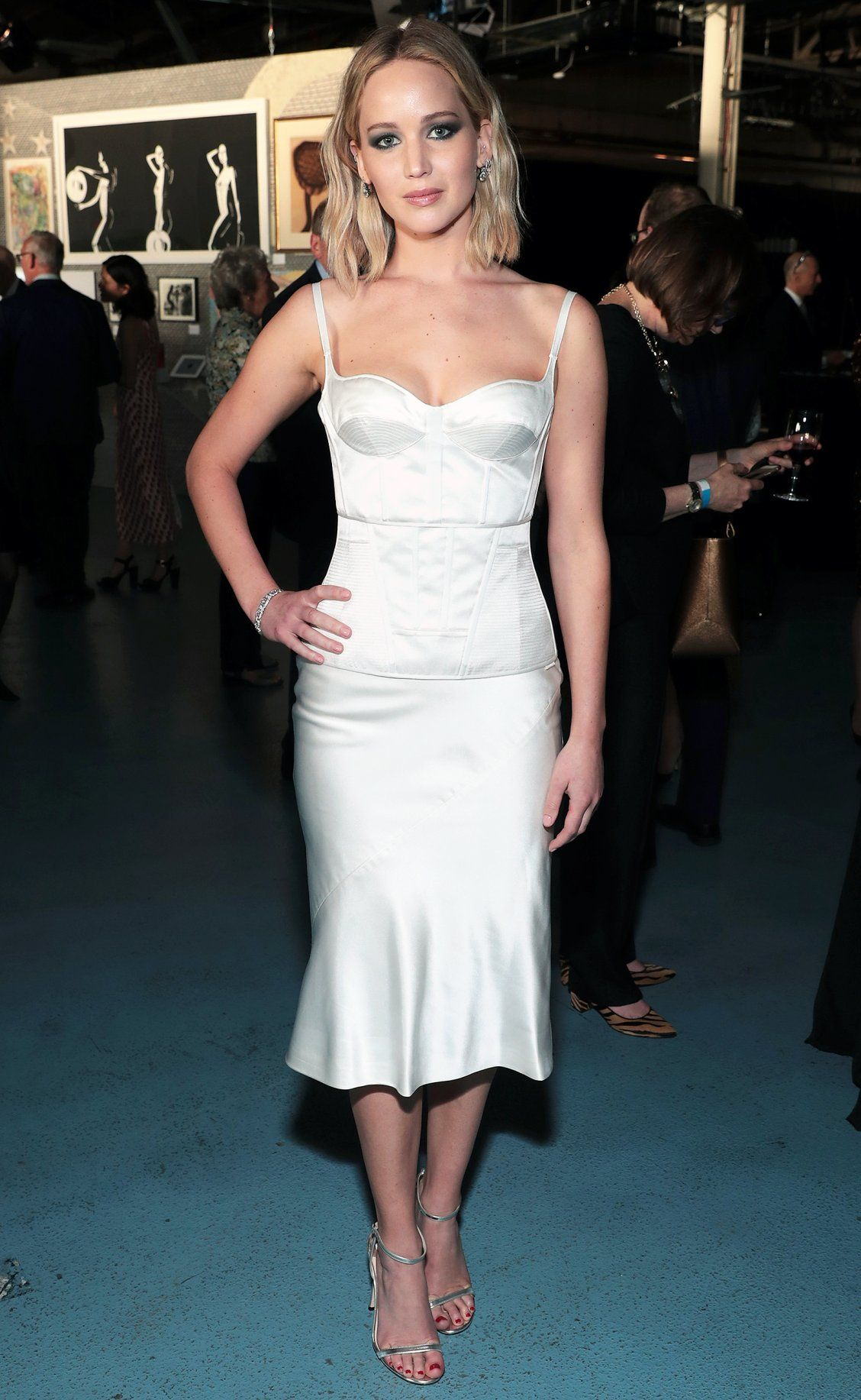1d4da3460fd617 Jennifer Lawrence in a white bustier midi dress