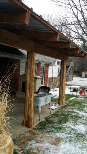 Cedar post retrieved from the woods to make this cool for Rustic covered decks