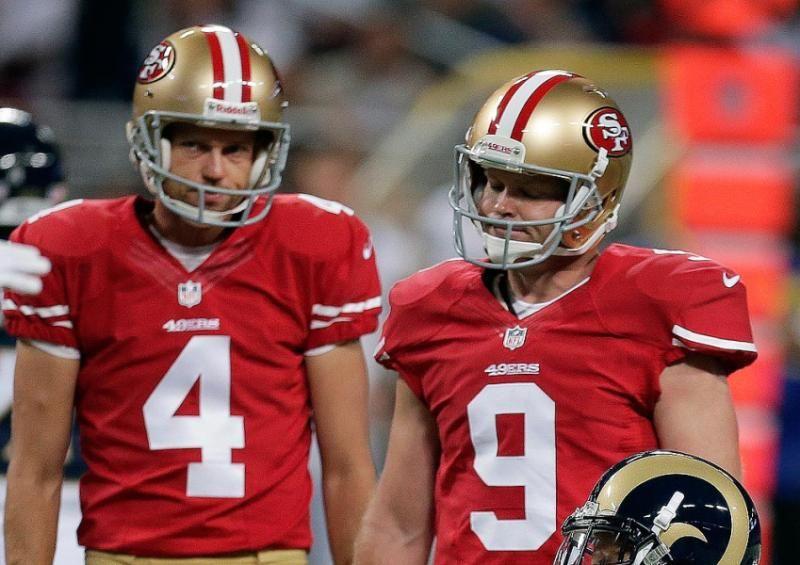 San Francisco 49ers kicker Phil Dawson, right, stands next