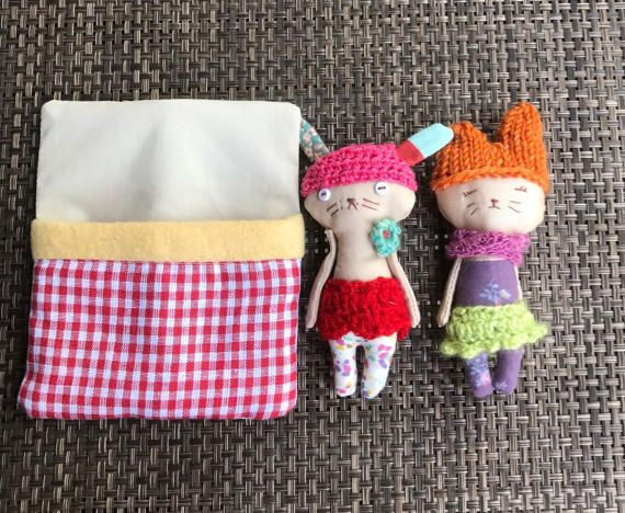 Two friends sleeping snugly together in a bed. The bed bag holds the dolls together and makes this play set ideal for travel and storing away.  They can be converted into fun and whimsical pendants with A Long cord which is provided. Upon request they can be made into pins for clothing or bag.    Made in a pet free, smoke free environment, these dolls are approximately 4 inches or 10 cm tall. The bodies may be cleaned with a damp cloth. Gentle play is recommended.       I gift wrap the…
