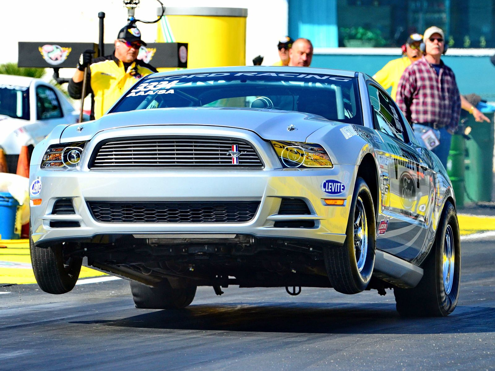 Michigan drag racer chris holbrook launches his 2013 cobra jet he became the first driver