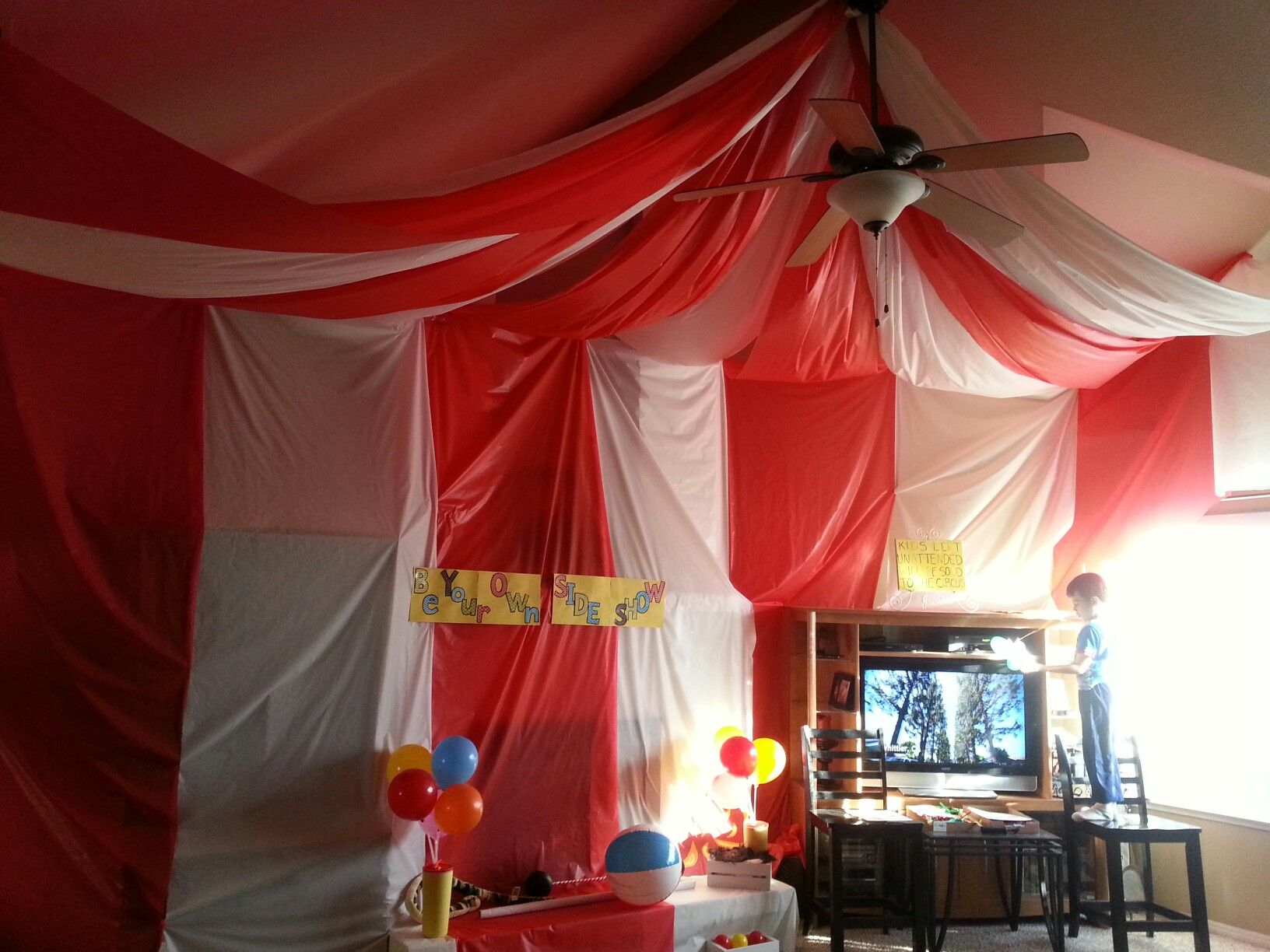 DIY Carnival circus tent. Roll of red & white tablecloths ...