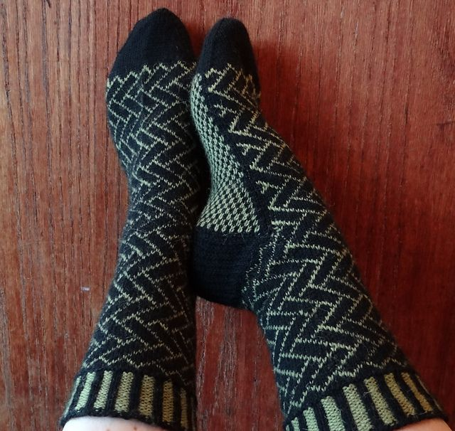 The detail in the pattern in amazing.  Someday I'll be able to make those, but I should probably figure out the basics of socks first!