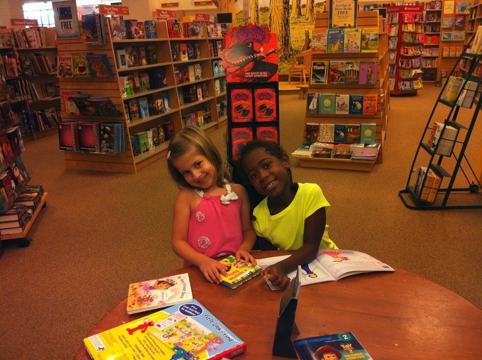 Julia and Devin: Friends since daycare reading books that they love.
